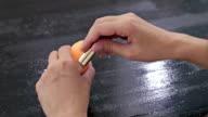 Close up shot of womans hands opening contour face makeup concealer tool video