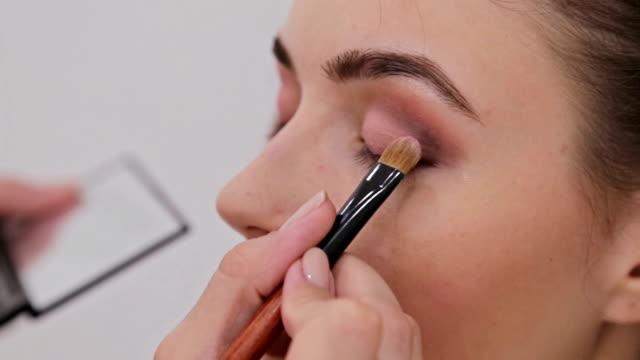 Close up shot. Professional make-up artist applying eyeshadow video