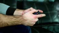 Close up slow motion shot of male hands playing video games with a gamepad or joystick video