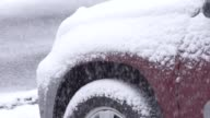 Close up snowing on car slow motion video