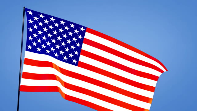 close up USA flag blue sky video