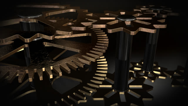 Close up view of animated rotating gold gears video