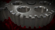 Close up view of animated rotating steel gears video