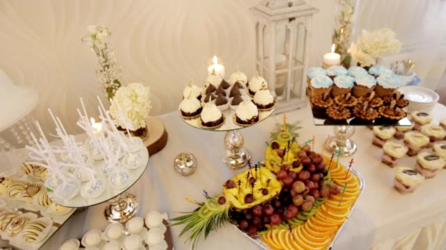 Close up view of colorful candy bar at a wedding hall. Dolly shot. video