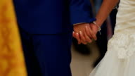 Close up view of couple holding hands having wedding ceremony in church video