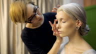 Close up view of female model making up video
