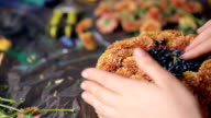 Close up view of hands making basket of flowers video