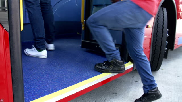 Close Up View Of Passenger's Feet Boarding Bus video