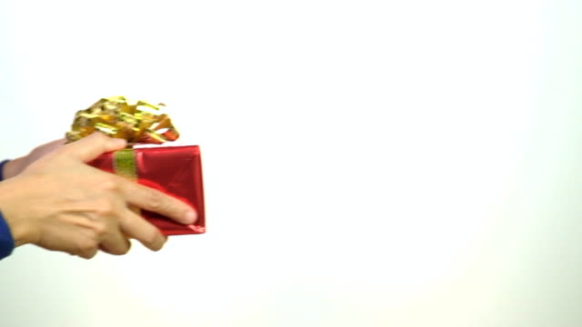 Close up woman hand send red christmas gift on white background video