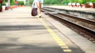 Close up woman leg while walking on platform video