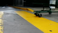 Close up woman pushing shopping cart walking on the yellow sidewalk in front of buy low foods supermarket video
