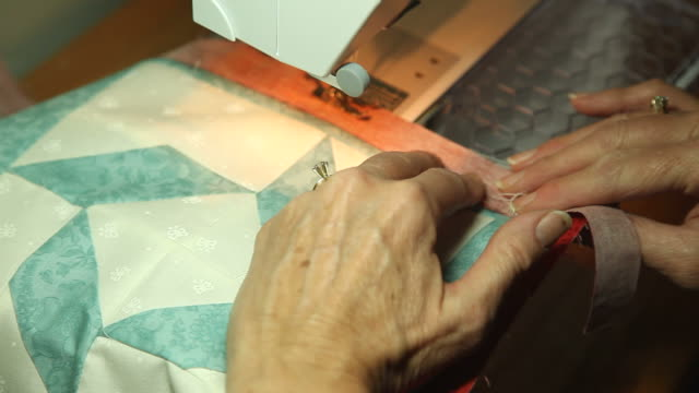 Close Up Woman Sewing Quilt video