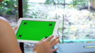 Close Up women Holding Blank Tablet PC With Green screen video