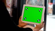 Close Up women Holding Blank Tablet PC With Green video