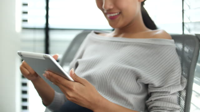 Close up Young Asian woman with digital tablet video