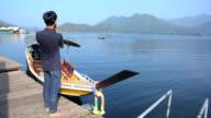 close up : young man take a photo on lake video