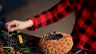 Close view of florist hands making flower composition in office video