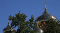 Close view of Russian church golden domes and crosses on blue sky video