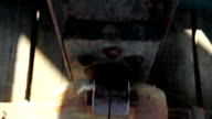 Closer image of the bolt and the rusty beam video