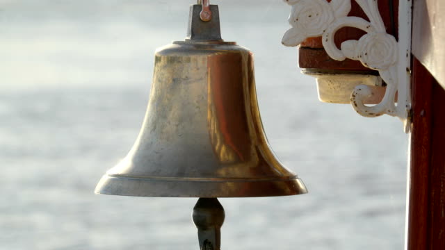 Closer look of the golden bell hanging on the side video