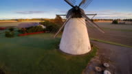 Closer look of the old windmill in the field video