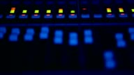 Close-up  a sound control desk. Audio engineer operates his instrument, recording equipment, during a night show at concert hall video