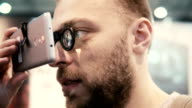 Close-up bearded attractive man uses virtual reality glasses video