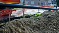 Close-up Big Long Pipe Climb Down Into Earthen Trench video
