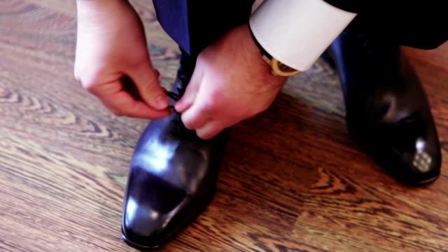 Close-up black shoes dressing video
