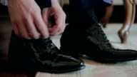 Close-up black shoes dressing video