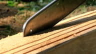 close-up blade of chainsaw cutting wood video