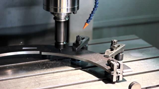 Close-up CNC  Machine milling drilling steel part video