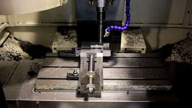 Close-up CNC machine milling some steel part video