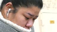 Closeup crying asian woman, slow motion video