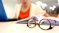 close-up eyeglasses, woman study education video