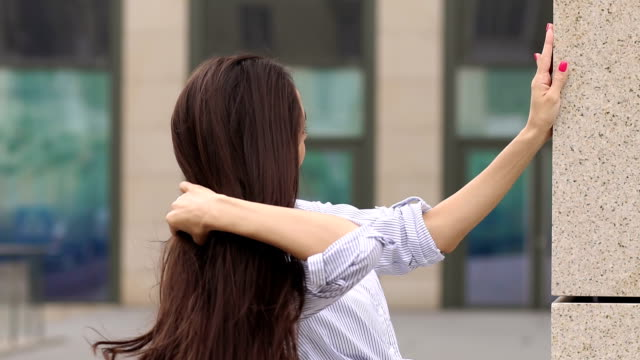 Close-up face of long-haired girl in the city. video