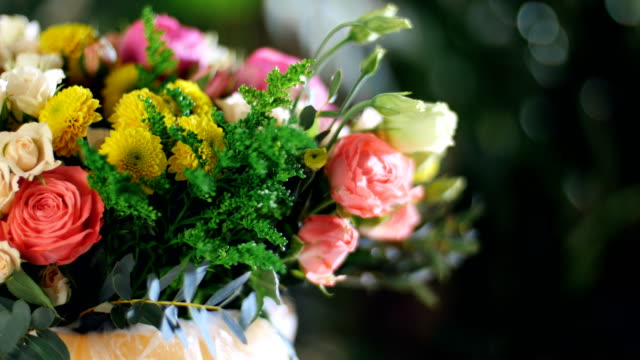 close-up, Flower bouquet in the rays of light, rotation, composition consists of Rose david austin, Rose cream grace, Rose barbados, Eustoma, Santini , Ornithogalum, eucalyptus video