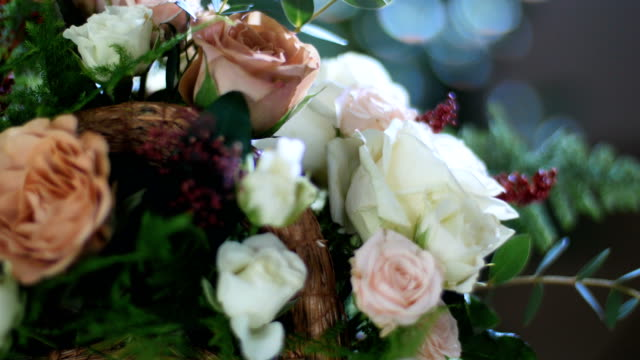 close-up, Flower bouquet in the rays of light, rotation, consists of Rose cappuccino, Snowflake rose, Rose yana creamy, Plamosus, eucalyptus, solidago, Rose of avalanche video