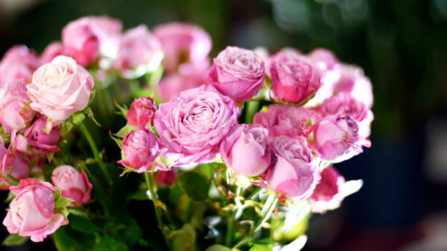 close-up, Flower bouquet in the rays of light, rotation, the floral composition consists of pink roses, Divine beauty video