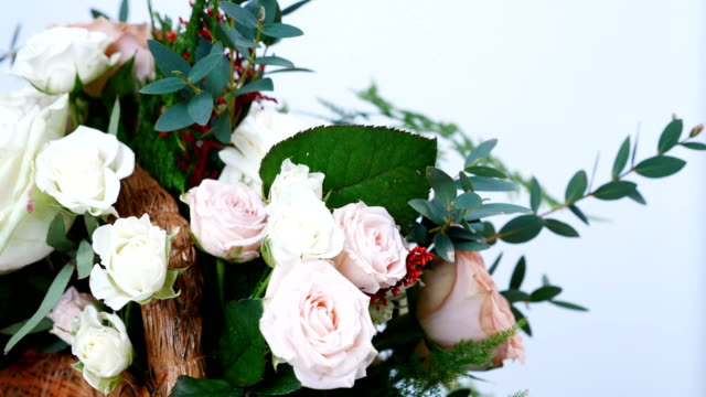 close-up, Flowers, bouquet, rotation on white background, consists of Rose cappuccino, Snowflake rose, Rose yana creamy, Plamosus, eucalyptus, solidago, Rose of avalanche video