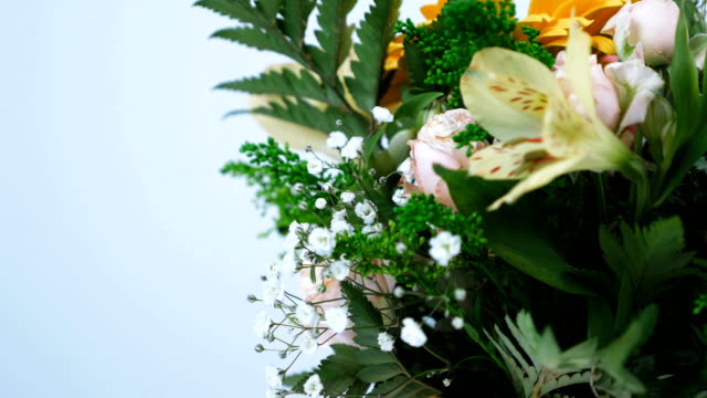 close-up. Flowers, bouquet, rotation on white background, floral composition consists of gerbera, Rose pion-shaped, Alstroemeria, solidago, gypsophila, Arachniodis video