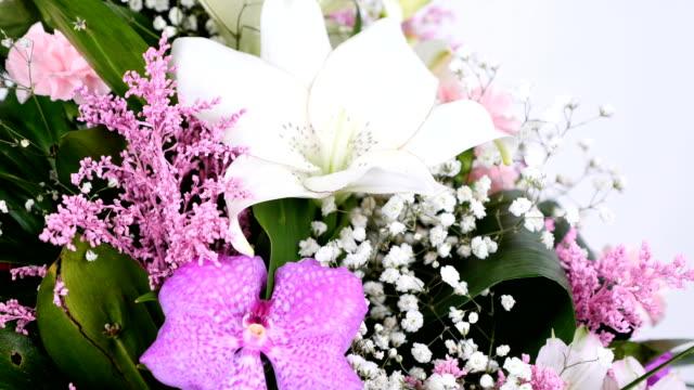close-up, Flowers, bouquet, rotation on white background, floral composition consists of Phoenix robbeli, eucalyptus, Chrysanthemum, Rose lydia, Carnation, gypsophila, solidago video