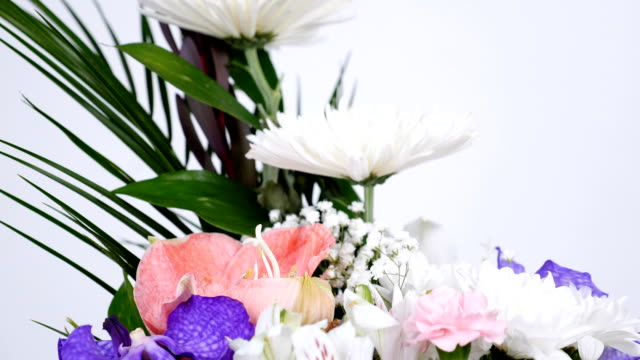 close-up, Flowers, bouquet, rotation on white background, floral composition consists of Leucadendron, Chrysanthemum anastasis, Amaryllis pink, Orchid vanda, Alstroemeria video