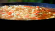 Close-up footage of a boiling plov (pilaf) - a traditional middle-East dish video