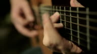 closeup footage on hands playing an acoustical guitar video