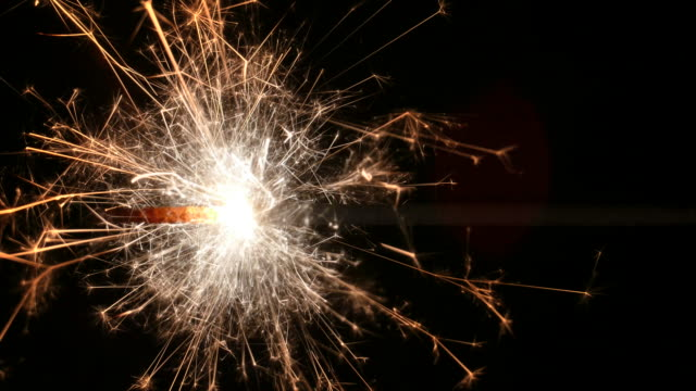 Closeup Fuse/Sparkler Spectacularly Burning/Sizzling Across Screen, Sparks Flying video