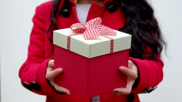 A close-up giving a gift video