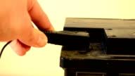 closeup hand plug car battery charger black clamp accumulator video
