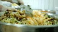 closeup hands of chef preparing a salad mixing vegetables video