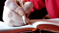 Closeup hands writing in diary video